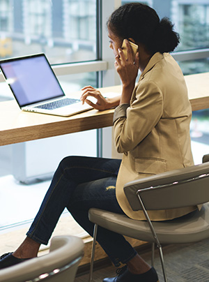 Woman using multiple devices